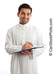 Smiling businessman writing in folder - A smiling ethnic...