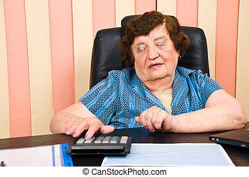 Elderly corporate woman working oin office - Elderly...