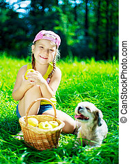 girl with a dog - happy girl with a dog having a picnic on a...