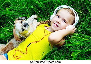 girl with a dog - happy girl with a dog listening to the...