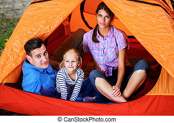 weekend in camping - Happy young family enjoy their holidays...