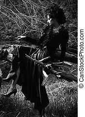 black widow - Gorgeous gothic woman wearing long black dress...