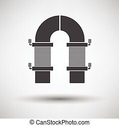 Electric magnet icon on gray background with round shadow....