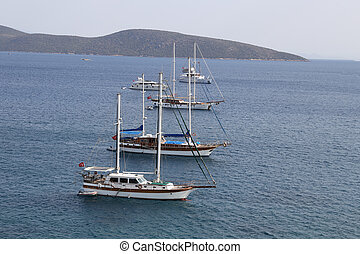 Sailboats in front of Bodrum Castle in Aegean Turkey