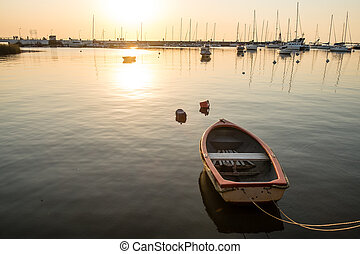 Colonia marina - Small recreational boat moored in Colonia...