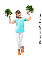Smiling elementary school age girl showing fresh parsley -...