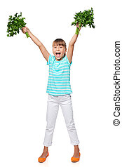 Smiling little girl showing fresh parsley screaming of joy -...
