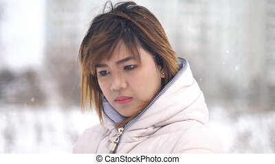 Young Asian Woman winter portrait. Shallow DOF
