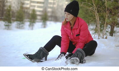 Young Thai Woman playing with snow