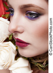 Woman in beauty image with perfect make up and surrounded by...