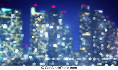 flashing lights of night city blur loopable background -...