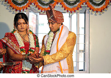 Wedding Rituals - A hindu groom and bride in a traditional...