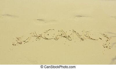 Vacancy sign on sand - Vakancy word on the sand beach on a...