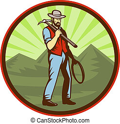 Miner carrying pick axe with mountains set inside an oval