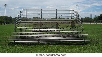 Bleachers on Field - Metal bleachers on grass sports field