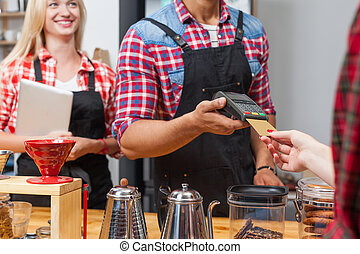 Close up credit card payment coffee shop bar counter barista...
