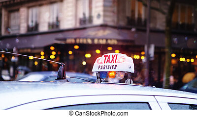 Taxi in Paris - Paris Taxi sign on the roof of a...