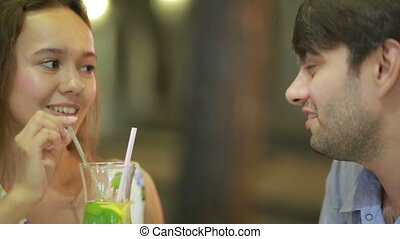 couple in love in an outdoor cafe Man and beautiful woman on...