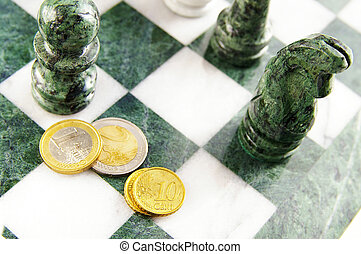 Euro coins on a chess board with pieces