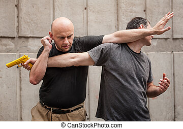 Gun Disarm. Self defense techniques against a gun point. -...