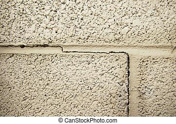 crack line in a cinder block foundation