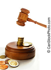 Euro coins and court gavel on white