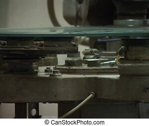 at the glass factory - close-up grinding the cutting glass...