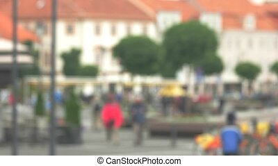 Blurred view of street. People walking in the background....