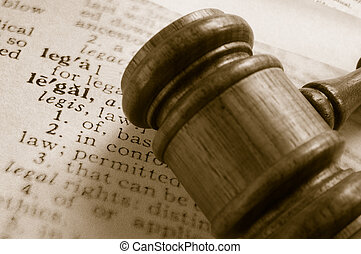 court gavel and legal definition, closeup from above