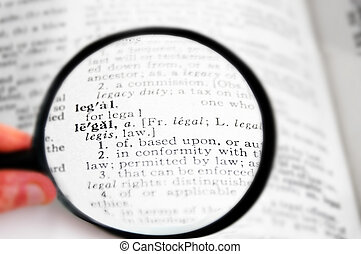 closeup of the word Legal in a dictionary, with magnifying glass
