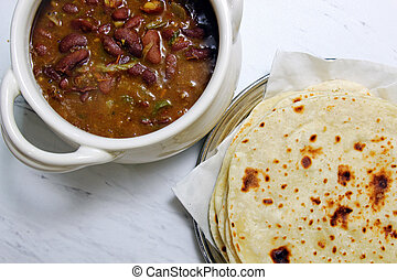 Rajma and Kulcha - A bowl with Rajma and a plate of Kulchas