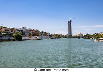 View of Guadalquivir River and Triana Bridge in Seville,...