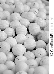 assortment of golf balls in a pile