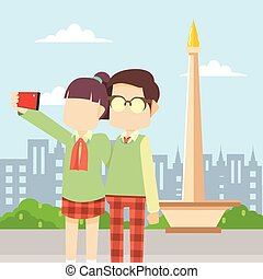 girl and boy taking selfie infront of monas