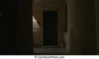 Camera moves along dark corridor. Narrow passage through...