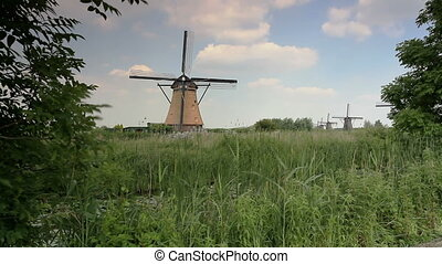 old windmill - traditional windmill in netherlands -...