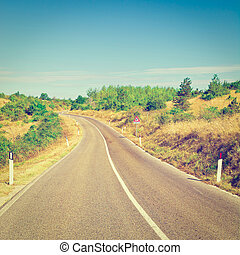 Road - Winding Asphalt Road between Autumn Hills of the...