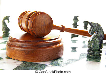 chess pieces and law gavel, over white