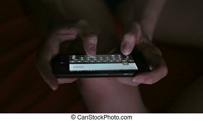 Young woman fingers typing on her smart phone