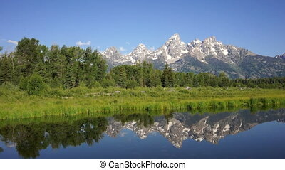Smooth Water Reflecting Mountains Grand Teton National Park...