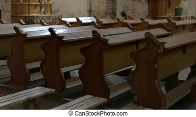 Row of empty church benches. Brown benches covered in dust....