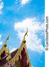 gable apex on a background of blue sky