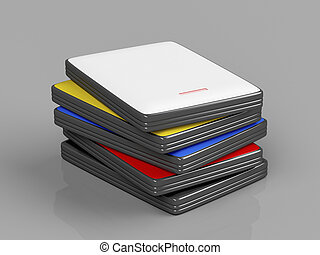 Stack with portable hard drives with different colors on...
