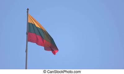 Lithuanian flag on sky background. Banner waving in the...