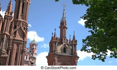 Red church on sky background. Big cathedral at daytime....