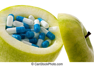 Apple with tablets capsules. Symbol for vitamin tablets
