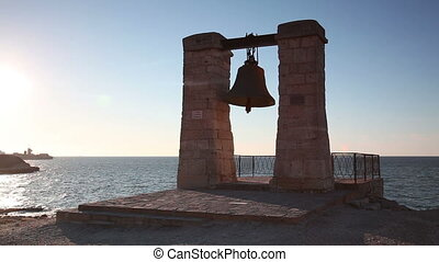 Alarm ancient bell on the bank of the Black Sea