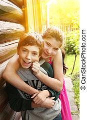 teenager siblings brother and sister hug close up