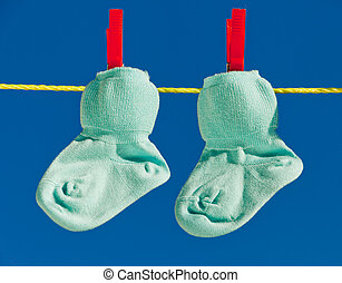 Baby socks on laundry line to dry
