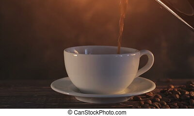 steaming coffee on dark brown background - steaming coffee...